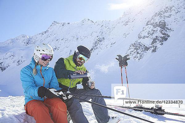 Austria  Tyrol  Kuehtai  two skiers in winter landscape having a break