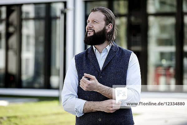 Portrait of bearded businessman watching something