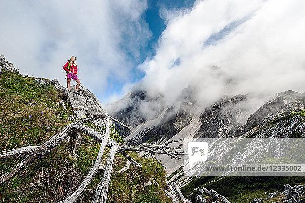 Austria  Salzburg State  Filzmoos  Female hiker looking at view