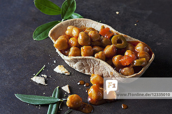 Chick-pea stew with green olives in edible bowl Chick-pea stew with green olives in edible bowl