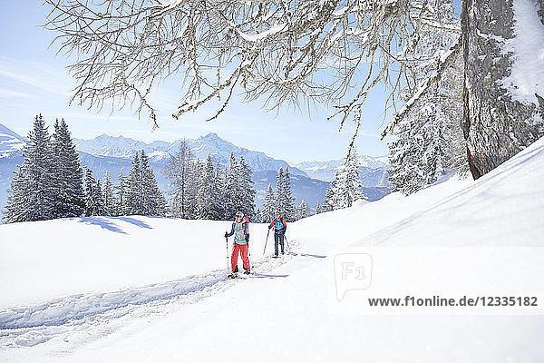 Austria  Tyrol  couple snowshoeing