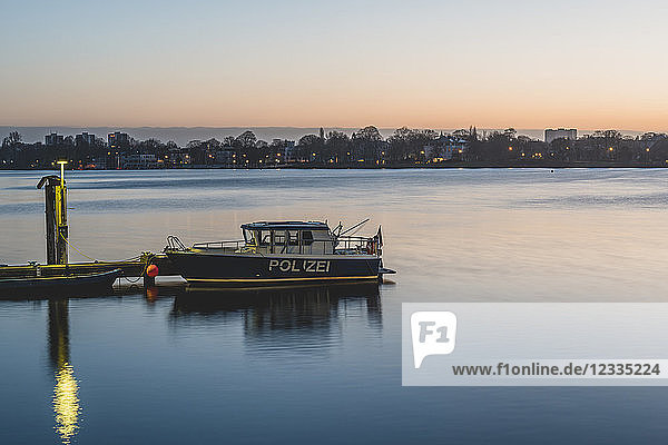 Germany  Hamburg  Outer Alster Lake  mooring area  police boat in the morning