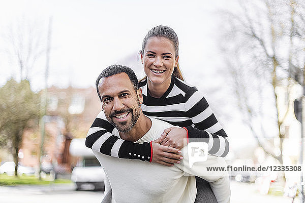 Portrait of happy couple having fun outdoors