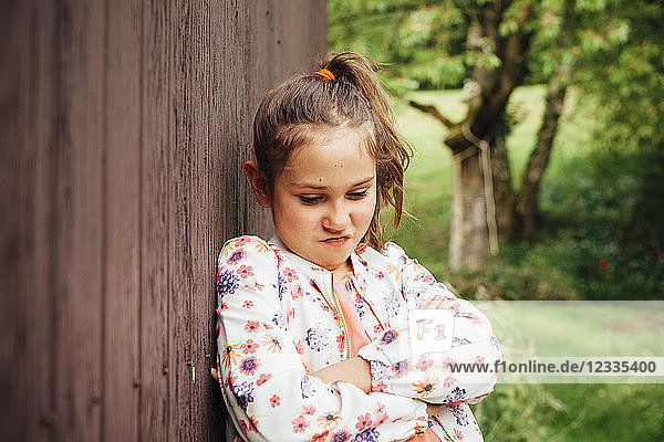 Portrait of little girl pouting mouth