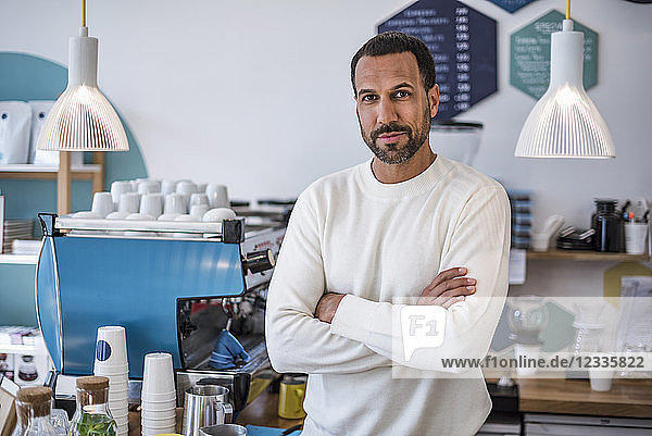 Portrait of confident owner of a cafe