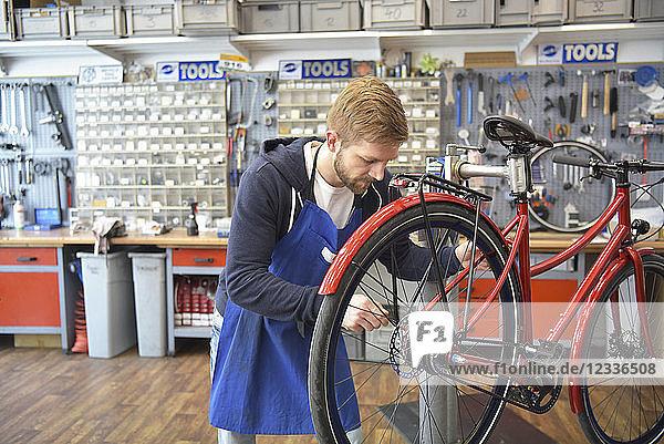 Bicycle mechanic working in his repair shop