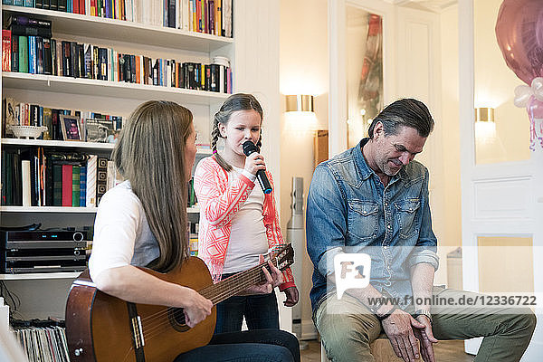 Happy family making music together at home