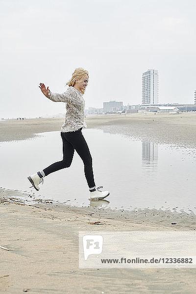 Netherlands  Zandvoort  happy young woman having fun on the beach