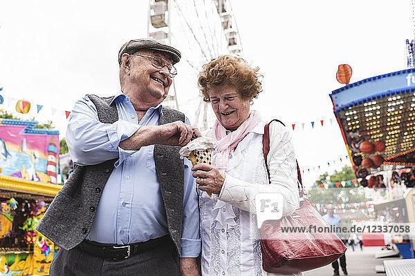 Senior couple having fun together on fair