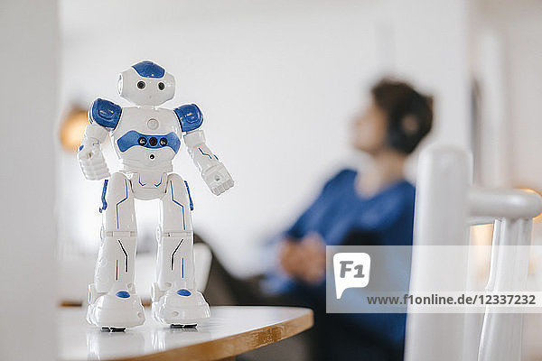 Robot on table with man in background
