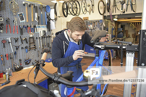 Bicycle mechanic working in his repair shop