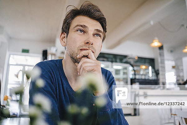 Man in a cafe thinking