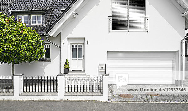 Germany  Cologne  white new built one-family house with garage