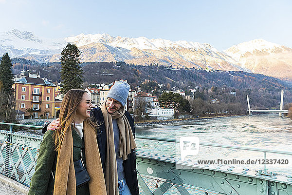 Austria  Innsbruck  happy young couple strolling together in winter