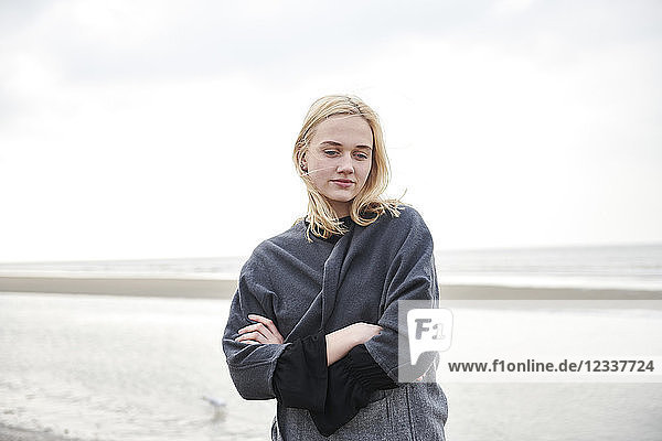 Netherlands  portrait of blond young woman on the beach