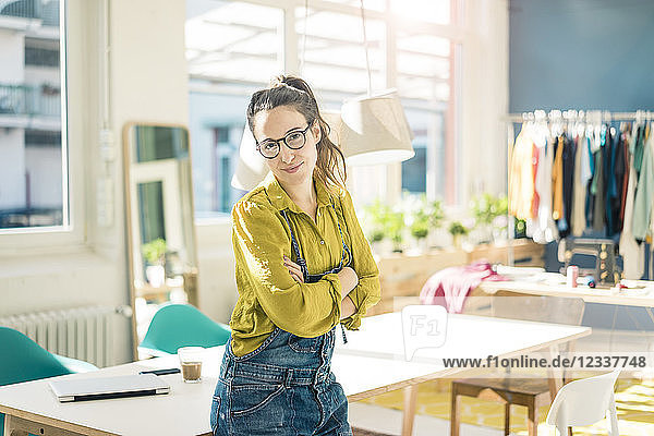 Portrait of smiling fashion designer in her studio