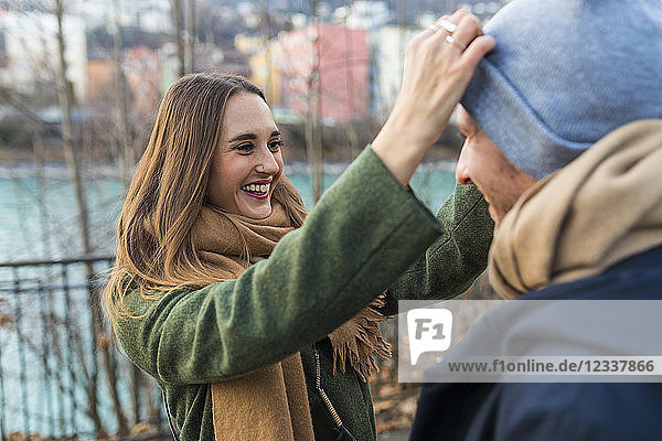 Portrait of happy young woman having fun with her boyfriend at winter time