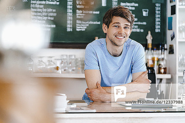 Portrait of smiling man in a cafe