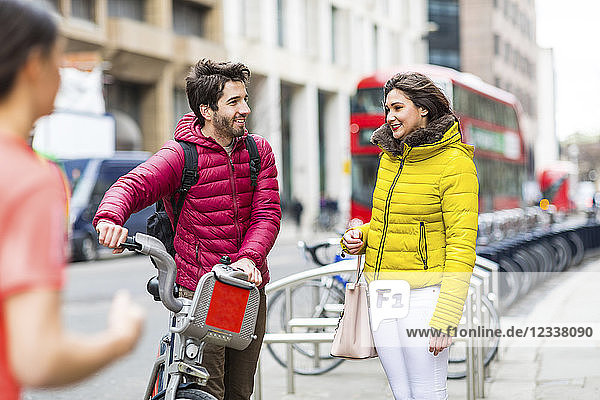 UK  London  young couple with rental bicycle from bike share stand