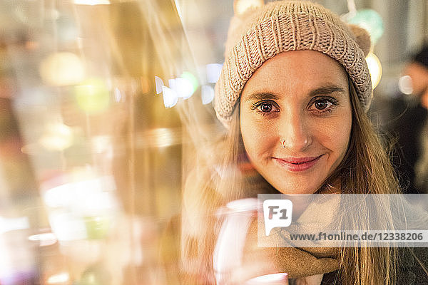 Portrait of smiling young woman at Christmas market