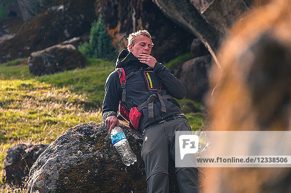 Rock climber taking break  Hatun Machay  Huaraz  Ancash  Peru
