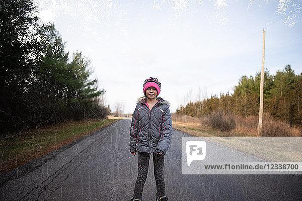 Girl rollerblading on country road  Bath  Canada