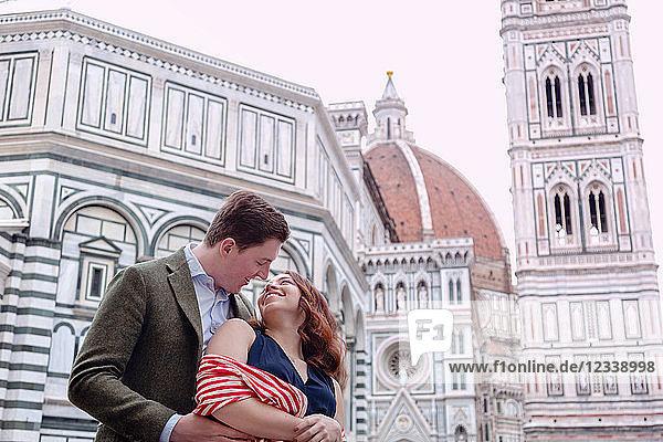 Young couple hugging  Santa Maria del Fiore  Florence  Toscana  Italy