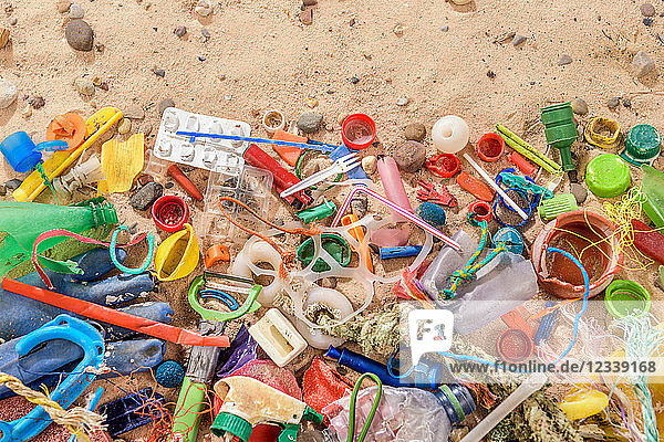 Discarded and polluting plastic garbage on sand collected from beach in North East England  UK