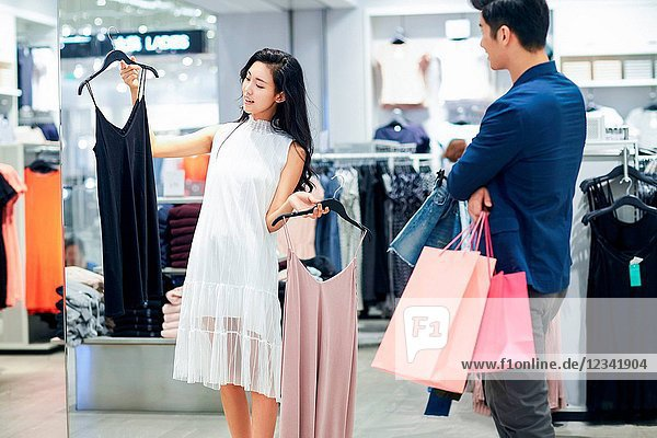 Young couples choose clothes clothing store