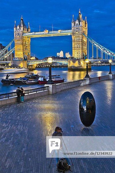 Photographing with tripod,  Egg shaped sculpture,  on background Tower Bridge,  Riverside Southwark,  River Thames,  London,  England,  UK,  United Kingdom,  Europe