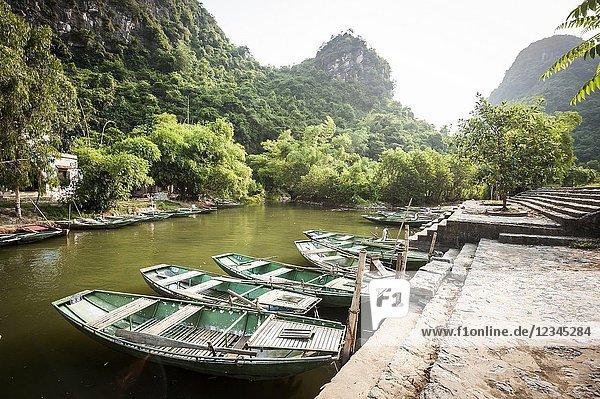 Boats in a river of Trang An karst Landscape Complex (Ninh Binh province  Vietnam).