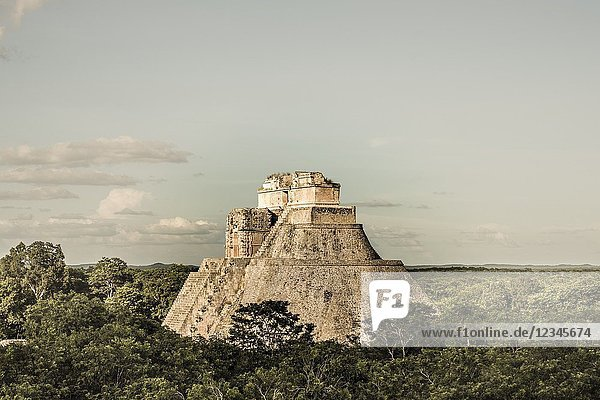 The Pyramid of the Magician (Pirámide del Mago) towering in the Maya City of Uxmal  Mexico.