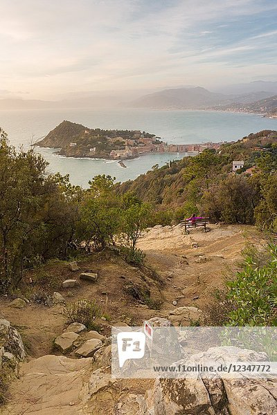 Tourist on a bench relaxing and stunning the panoramic view from Punta Manara  Sestri Levante  Genova Province  Liguria  Italy.