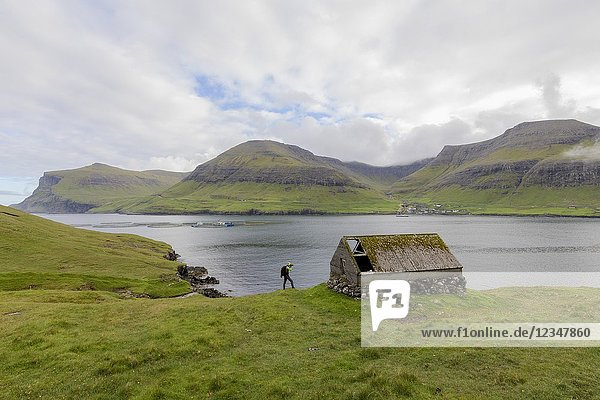 Photographer during the Drangarnir excursion  Vagar Island  Faroe Islands.