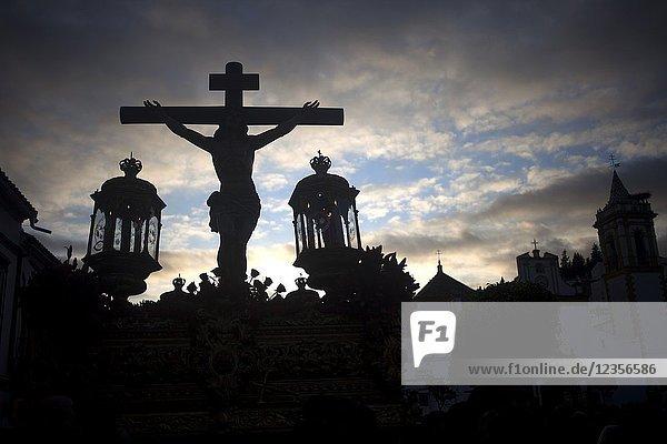 An image of Jesus Christ crucified is displayed during Easter Holy Week in Prado del Rey  Sierra de Grazalema  Andalusia  Spain.