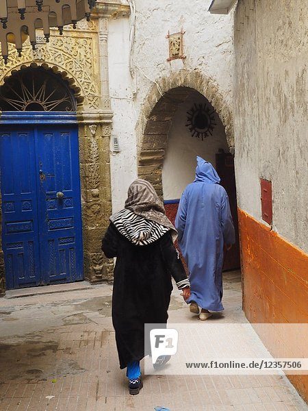 Women in a doorway  Medina  Essaouira  Morocco.