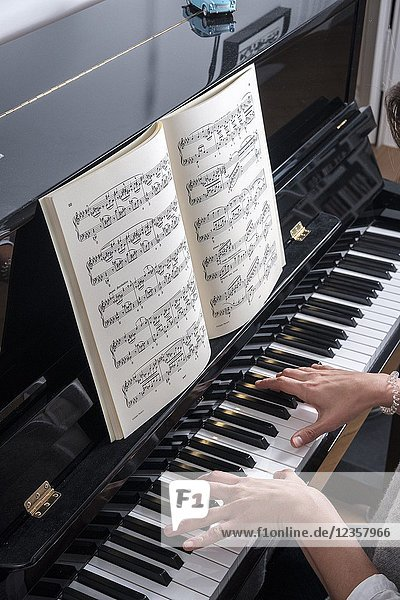 Woman plays piano -top view.