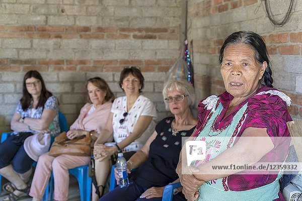San Miguel del Valle  Oaxaca  Mexico - Mexican women receive microfinance loans from the nonprofit En Via to support their small businesses. Isabel Santiago Garcia makes tamales in a small Zapotec town. Here she tells a group of international visitors about her business.