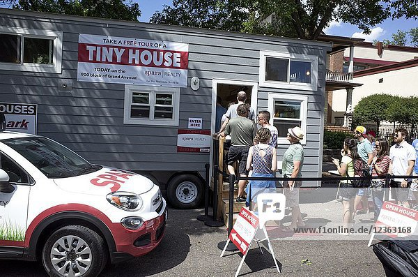 People in line to see exhibit of tiny house at Grand Old Day Street Fair. St Paul Minnesota MN USA.