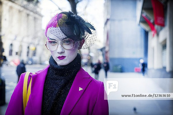 Close-up of elegant woman dressed in fashion walking in the street. London  England.