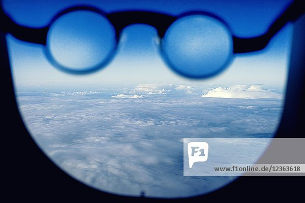 Close up of glasses in the window of a plane.