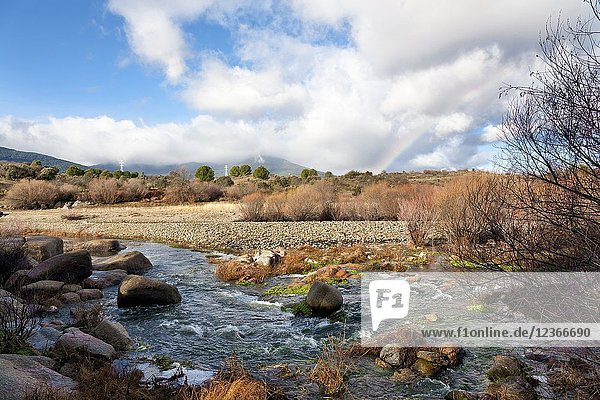 River Alberche ans clouds and a rainbow in the Sierra de Gredos. Avila. Spain