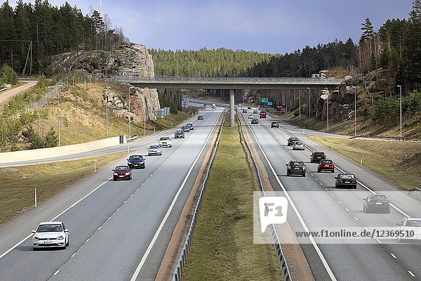 Motorway traffic on an overcast day of spring on Finnish National Road 1 in Salo  Finland
