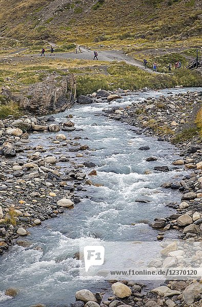 Ascencio river. Hikers walking in Torres Sector  Torres del Paine national park  Patagonia  Chile.