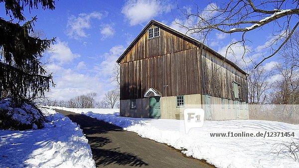 A wooden barn in snow  Pennsylvania  USA.