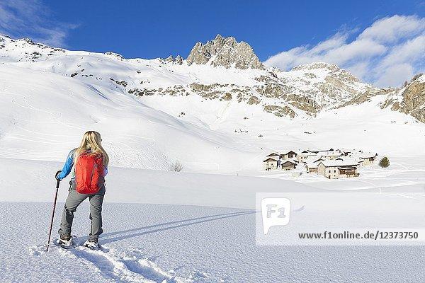 Young girl walks with snowshoes near the village of Grevasalvas  Engadin Valley  Graubünden  Switzerland  Europe.