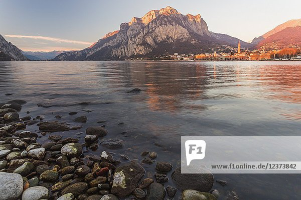 View of Lake Como surrounding the city of Lecco during sunset Lombardy Italy.