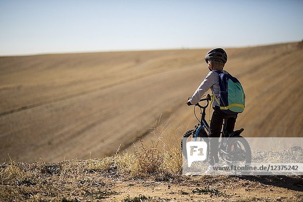 Boy riding bicycle. Ajalvir. Madrid Province. Spain.