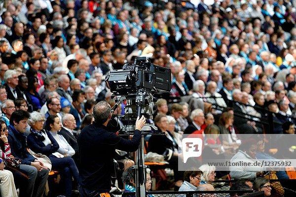 Protestant celebration at the Zenith of Strasbourg. TV camera.