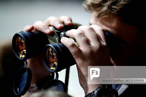 Youth using binoculars.